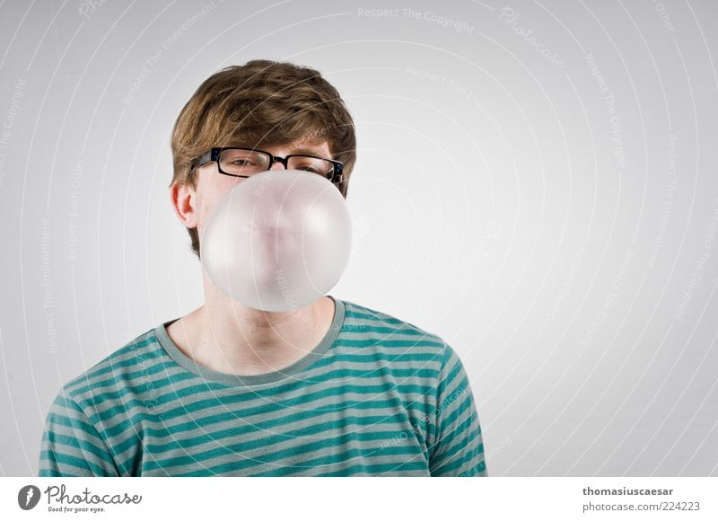 At the interview... Chewing gum bubble Lifestyle Human being Masculine Young man Youth (Young adults) Face 1 18 - 30 years Adults Sweater Eyeglasses Breathe