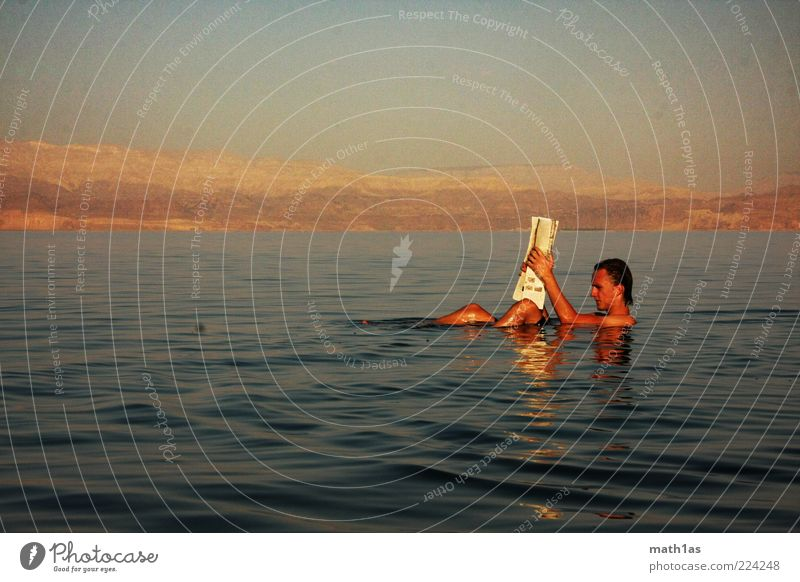 Human being Water Youth (Young adults) Ocean Relaxation Moody Adults Lake Contentment Sit Lie Masculine Esthetic Swimming & Bathing Cool (slang) Reading