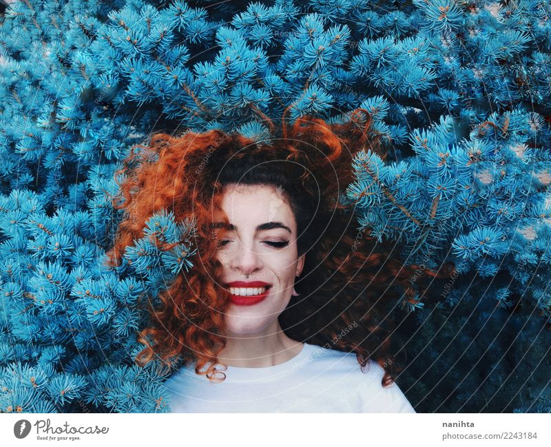 Young and happy redhead woman leaning in blue nature Human being Nature Youth (Young adults) Young woman Plant Blue Beautiful Tree Joy 18 - 30 years Face Adults