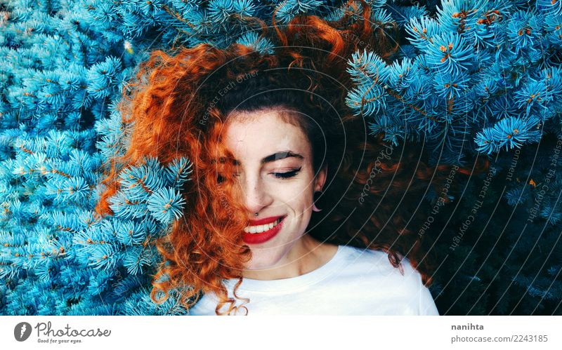 Young redhead woman and a blue tree Human being Nature Youth (Young adults) Young woman Blue Beautiful White Tree Joy 18 - 30 years Adults Environment Lifestyle