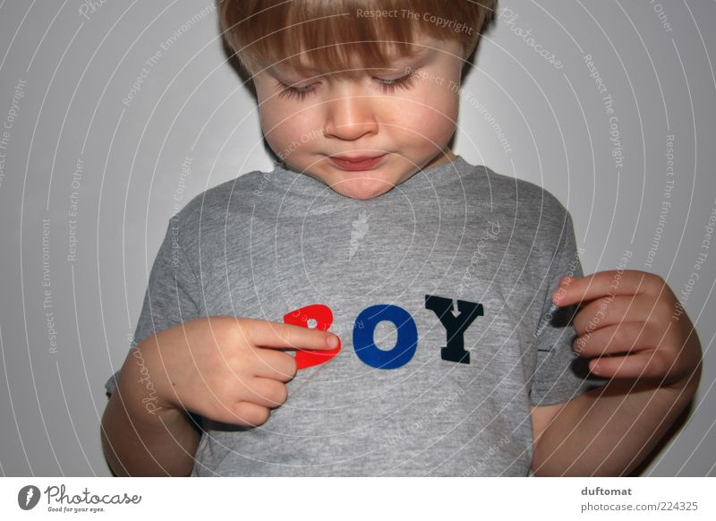 What am I Masculine Child Boy (child) Infancy 1 Human being 3 - 8 years Clothing T-shirt Characters Observe Think Reading Looking Growth Brash Curiosity Cute