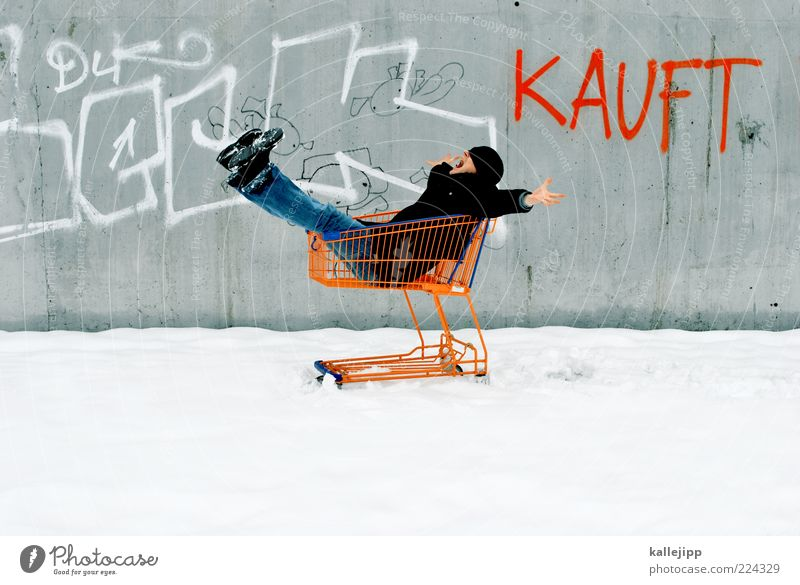 winter sales Lifestyle Shopping 1 Human being Winter Ice Frost Snow Jeans Coat Cap Characters Graffiti Free Happiness Shopping Trolley Consumption Concrete