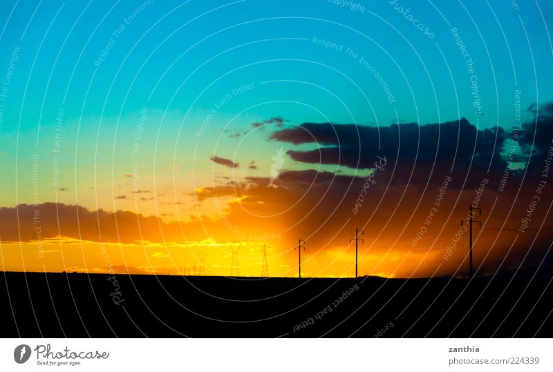 Sunset in the Desert Landscape Sky Clouds Horizon Sunrise Sunlight Autumn Blue Yellow Gold Black Uniqueness End Relaxation Colour Vacation & Travel Idyll Moody