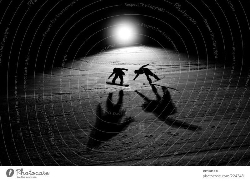 men in black Lifestyle Style Joy Leisure and hobbies Vacation & Travel Freedom Winter Snow Winter vacation Sports Winter sports Sportsperson Snowboard Ski run