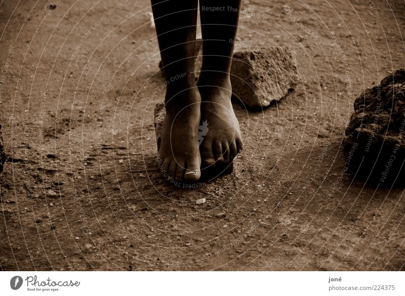 Human being Far-off places Playing Stone Legs Feet Brown Earth Poverty Hope Infancy Grief Floor covering Stress Toes Barefoot