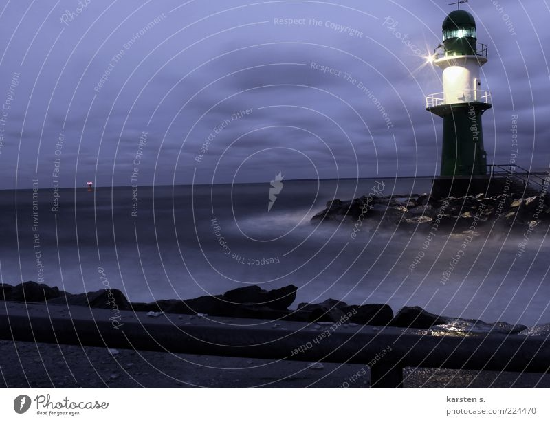 Water Blue Winter Cold Dark Coast Weather Wet Illuminate Lighthouse Mystic Signal Road sign Environment Cloud cover