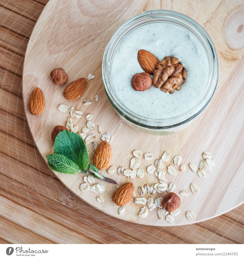 mint curd smoothie with granola Food Yoghurt Fruit Dessert Eating Breakfast Organic produce Diet Crockery Brown Green Cereal Home-made Meal Mint Natural Nut