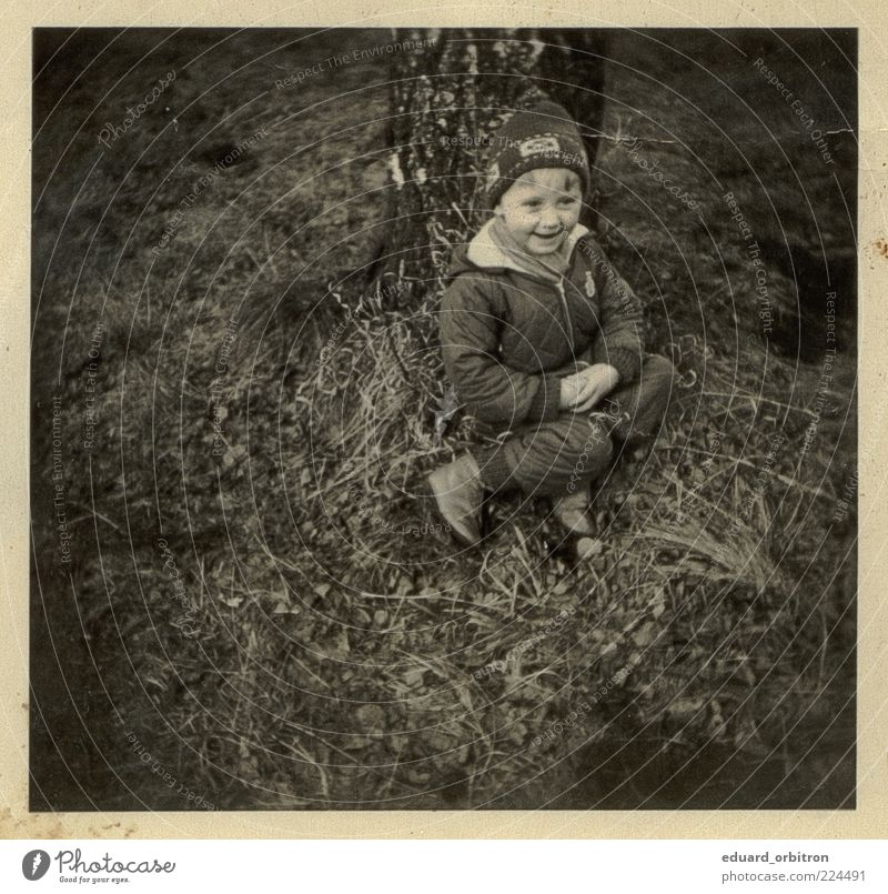 Remember me Infancy 1 Human being 3 - 8 years Child Tree Grass Pants Jacket Cap Laughter Sit Retro Joy Happiness Contentment Enthusiasm Black & white photo