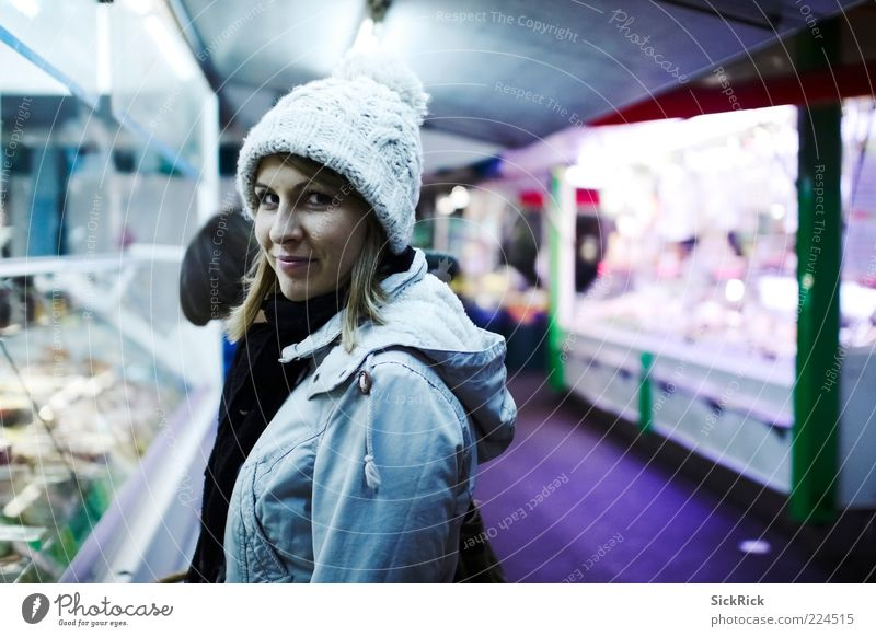 buying cheese Feminine Young woman Youth (Young adults) Woman Adults 1 Human being 18 - 30 years Marketplace Cap Shopping Looking Cold Blue Violet Colour photo