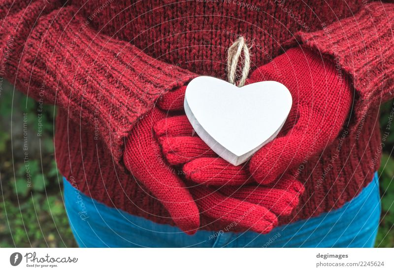 Hands in gloves and white heart Woman Nature Beautiful White Red Winter Adults Love Heart Romance Symbols and metaphors Conceptual design Valentine's Day Hold