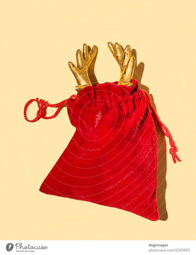 Deer horn in red Santa's bag Design Winter Decoration Feasts & Celebrations Christmas & Advent Hand Animal Red christmas claus Santa Claus Reindeer holiday