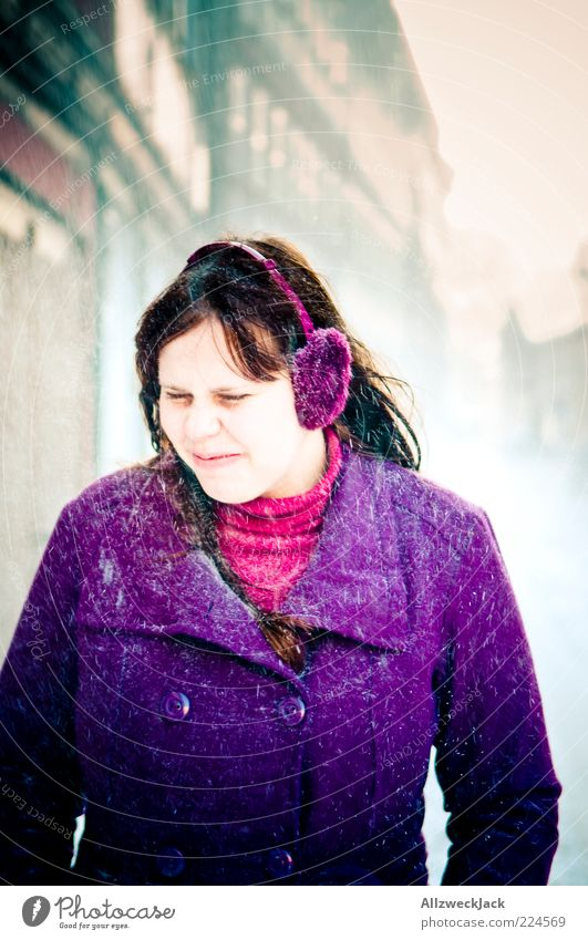 Purple against the snow Feminine Young woman Youth (Young adults) 1 Human being 18 - 30 years Adults Coat Ear protectors Brunette Long-haired Violet Unwavering