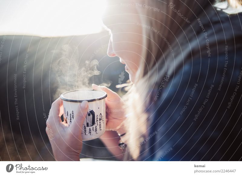 Young woman with steaming cup Hot drink Tea Mug Enamel Life Harmonious Well-being Contentment Senses Relaxation Calm Leisure and hobbies Trip Adventure Freedom