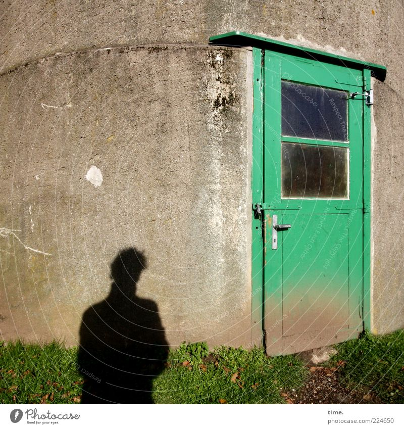 Greeting 2011 Human being Man Adults Grass Tower Building Wall (barrier) Wall (building) Window Door Old Dirty Entrance Pane Run-down Colour photo