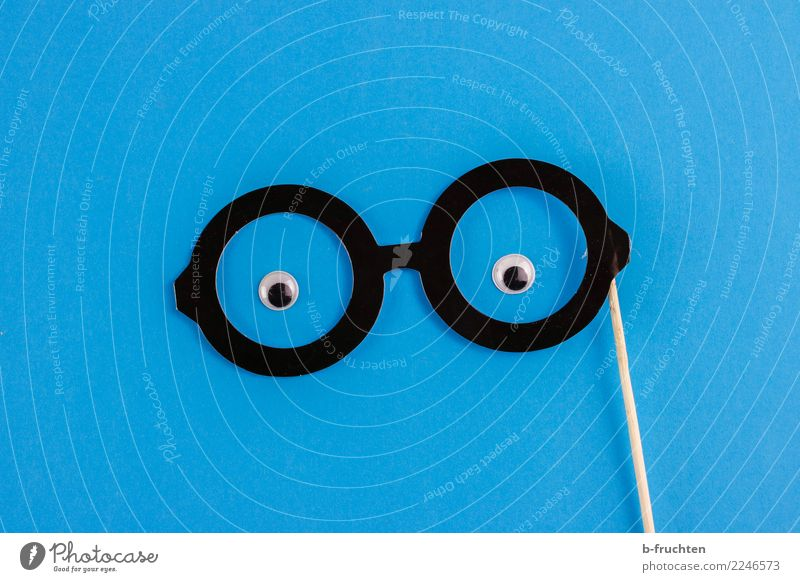 snoop Carnival Eyes Eyeglasses Paper Observe Looking Friendliness Curiosity Blue Black Watchfulness Requisite Vista Smart Man Masculine Colour photo Studio shot