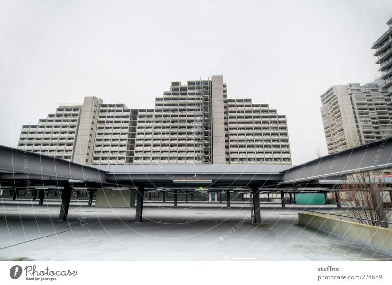 Less gloomy prospects Munich Outskirts House (Residential Structure) High-rise Parking garage Facade Concrete Gloomy Town Gray Exclusion Deprived area Ghetto