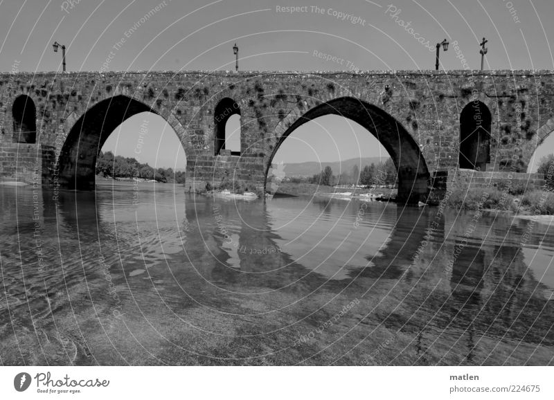 Overflow Deserted Bridge Wall (barrier) Wall (building) Historic Flow River Lantern Crucifix Water Calm Black & white photo Exterior shot Copy Space top