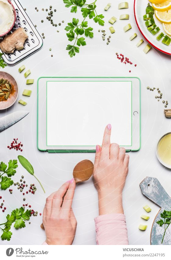 Female hands with Tablet PC on the kitchen table Food Nutrition Organic produce Vegetarian diet Diet Crockery Style Design Healthy Healthy Eating Kitchen