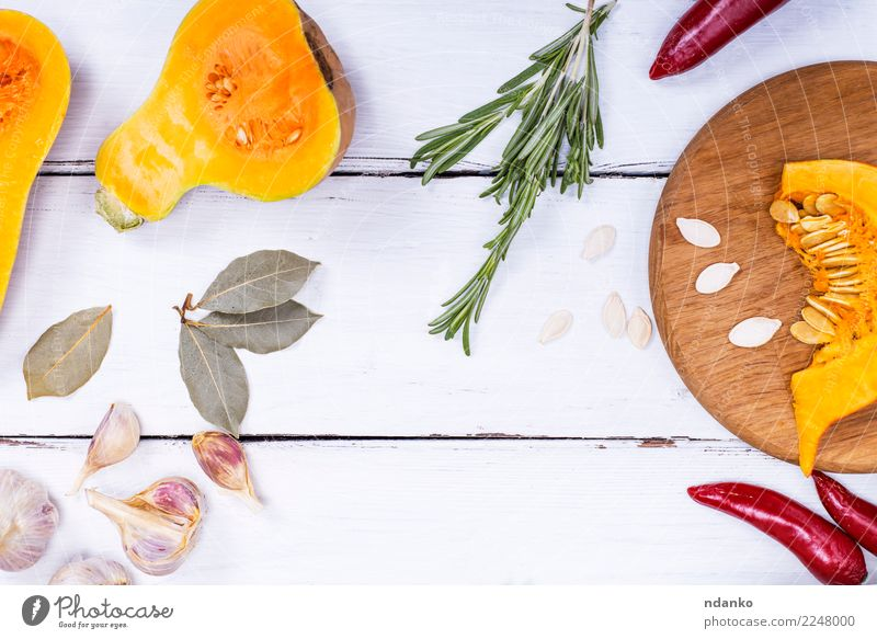 pieces of fresh pumpkin and spices Nature White Dish Eating Yellow Autumn Natural Wood Nutrition Decoration Fresh Table Herbs and spices Kitchen Vegetable