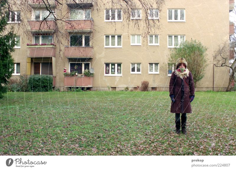Woman Human being Youth (Young adults) City Winter House (Residential Structure) Cold Meadow Window Adults Wait Facade Clothing Stand Gloomy Lawn
