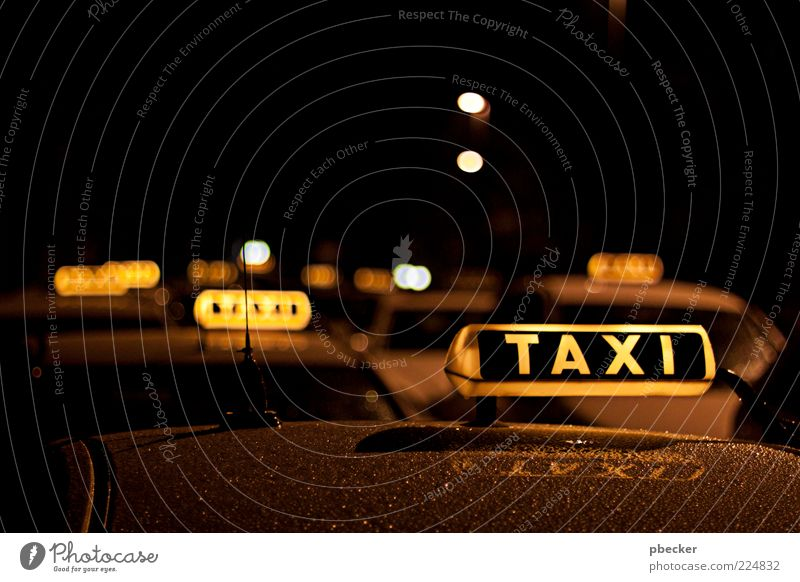 taxi Tourism Services Transport Means of transport Passenger traffic Vehicle Car Taxi Characters Signs and labeling Wait Simple Near Wet Yellow Black Patient