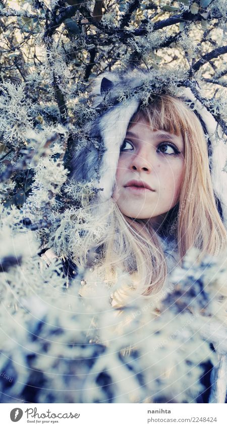 Young woman wearing a fur hat into the woods at winter Style Exotic Human being Feminine Youth (Young adults) 1 18 - 30 years Adults Environment Nature Winter