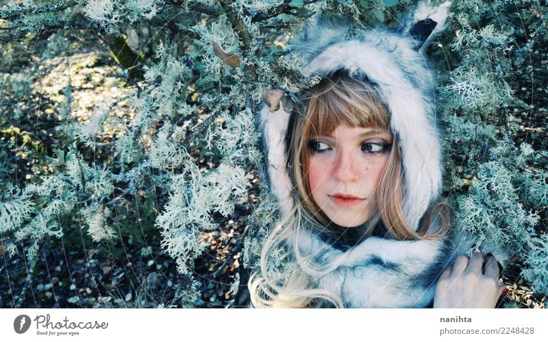 Young woman wearing a fur hat in the forest Style Exotic Beautiful Skin Face Senses Human being Feminine Youth (Young adults) 1 18 - 30 years Adults Environment
