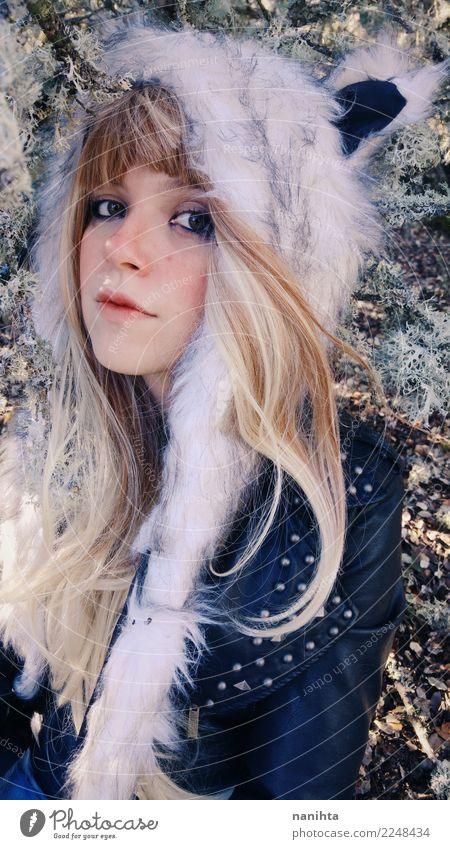 Young blonde woman wearing a fur hat Style Exotic Beautiful Human being Feminine Young woman Youth (Young adults) 1 18 - 30 years Adults Air Winter Clothing