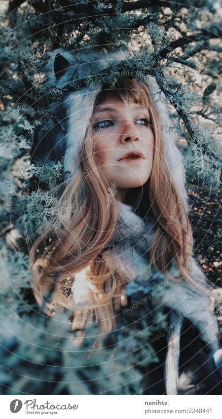 Young wild woman wearing a fur hat into the woods Human being Nature Youth (Young adults) Young woman Beautiful Tree Leaf Winter Forest 18 - 30 years Face