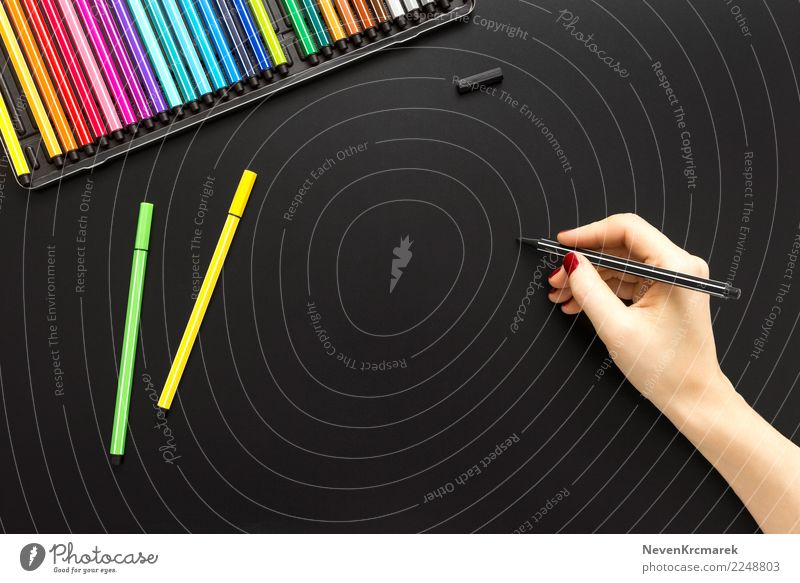 Tabletop scene with female hand writing Desk Hand Art Artist Work of art Write Hip & trendy Above Clean Blue Multicoloured Yellow Green Black Style Mock-up Pen