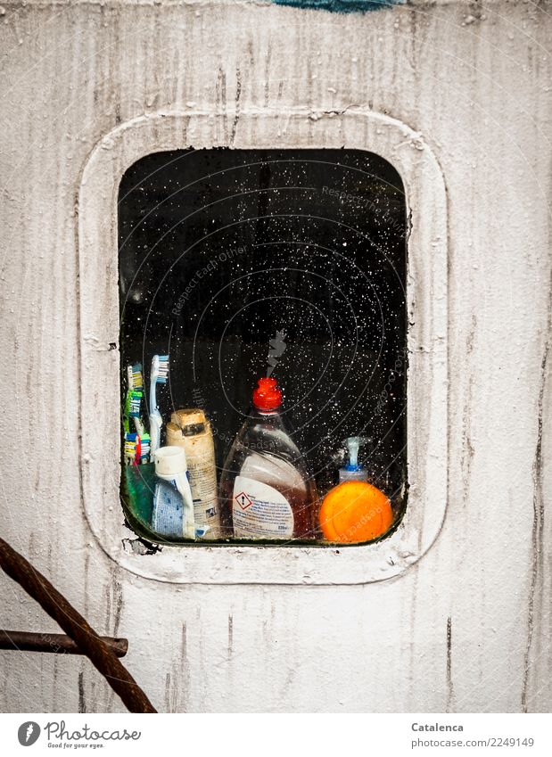 Curious view through the porthole of a fishing cutter. Fisherman Porthole Navigation Fishing boat Toothpaste Shampoo Toothbrush Green Orange Black White Moody