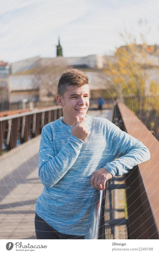 Portrait of Handsome teenage boy outdoors Lifestyle Joy Happy Leisure and hobbies Human being Boy (child) Man Adults Youth (Young adults) Teeth Smiling