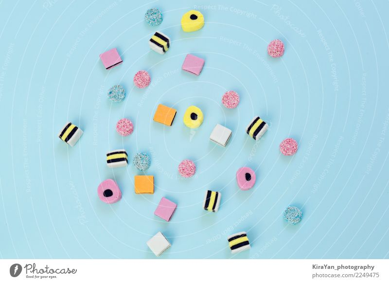 Colored candy scattered on the blue background Christmas & Advent Blue Colour Beautiful Joy Yellow Food Feasts & Celebrations Group Pink Copy Space Birthday