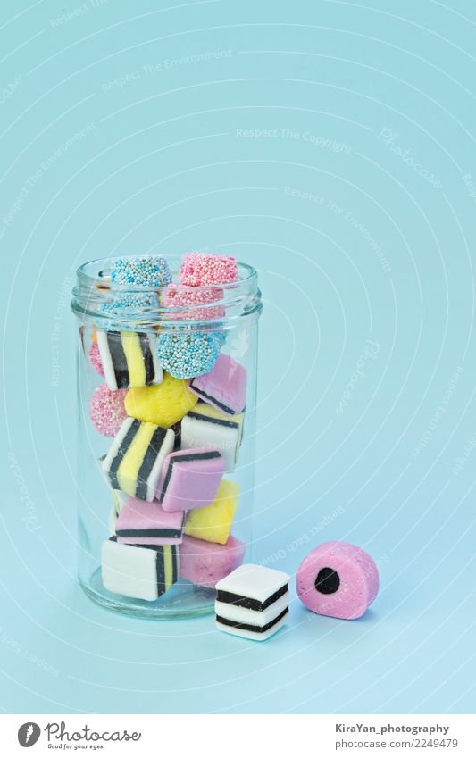Colored chewing sweets in a glass jar Dessert Candy Glass Joy Feasts & Celebrations Group Exceptional Bright Delicious Blue Yellow Pink Red Colour jelly