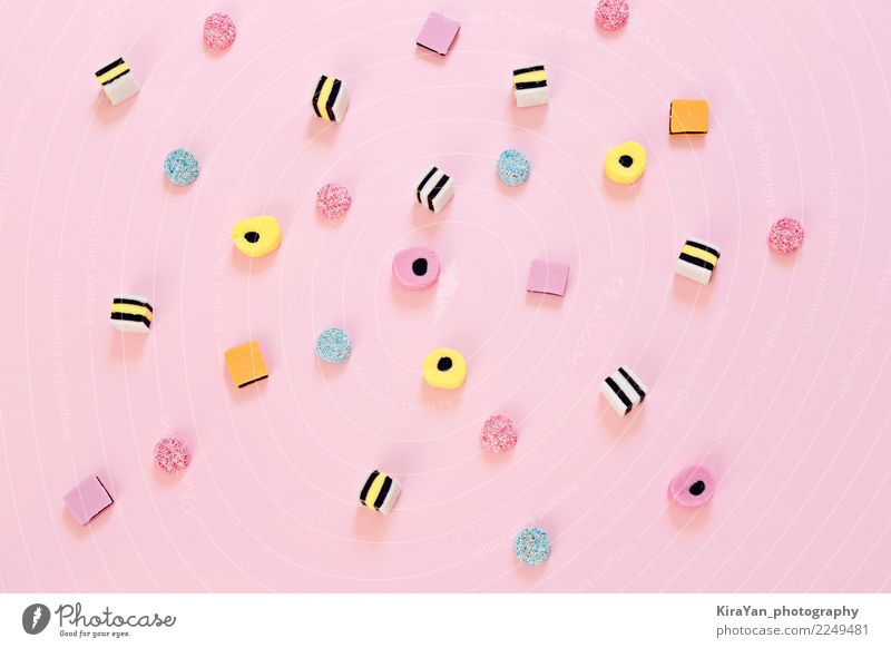 Colored candy scattered on the pink background Dessert Candy Eating Joy Party Feasts & Celebrations Group Exceptional Bright Delicious Blue Yellow Pink Colour