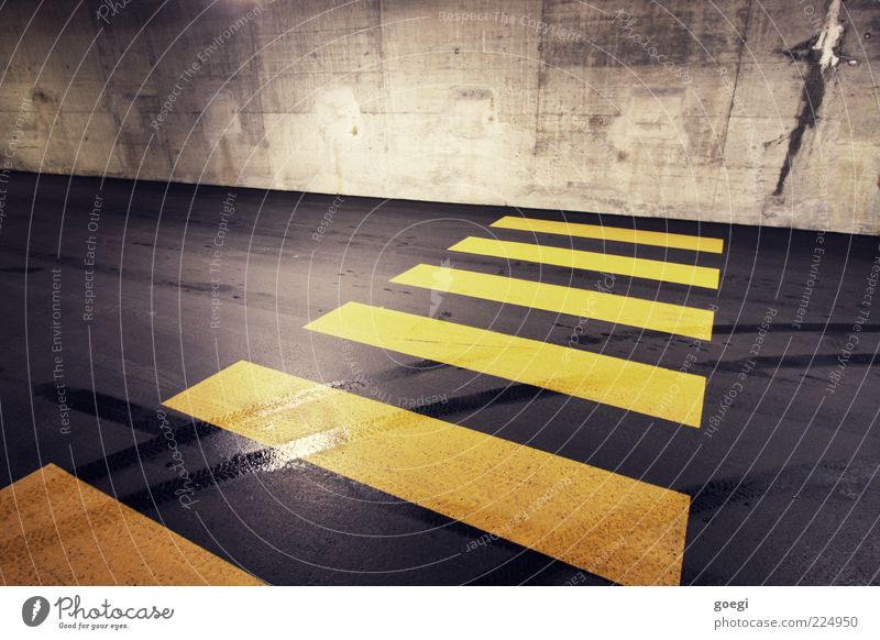 major obstacle Parking garage Wall (barrier) Wall (building) Street Concrete Road sign Line Yellow Gray Black Skid marks Zebra crossing Barrier Closed