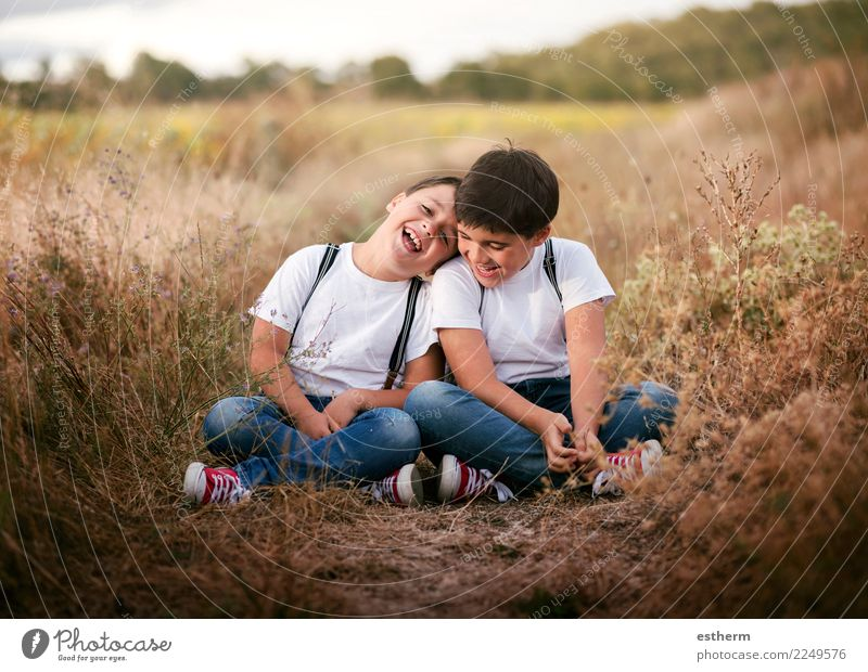 smiling brothers in the field Child Human being Joy Lifestyle Love Meadow Emotions Family & Relations Laughter Boy (child) Together Friendship Masculine Park