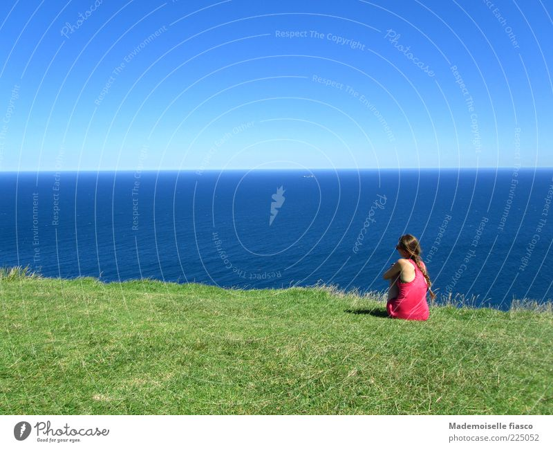 Wanderlust? Far-off places Summer vacation Feminine Young woman Youth (Young adults) 1 Human being Cloudless sky Beautiful weather Grass Hill Ocean Relaxation