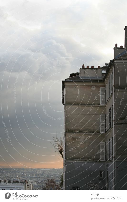 Paris Capital city Outskirts Building Wall (barrier) Wall (building) Facade Window Exceptional Threat Dark Town Vantage point Surrealism Clouds Weather