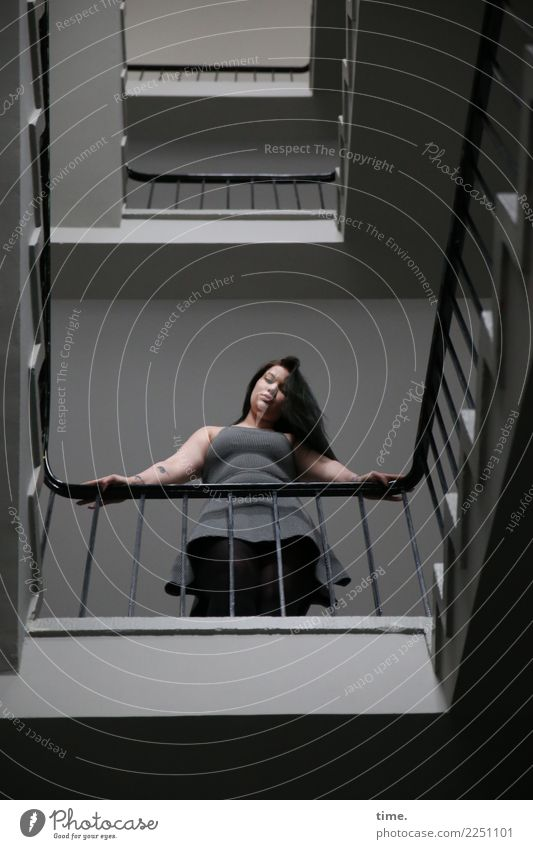 liqueur Feminine Woman Adults 1 Human being Stairs Staircase (Hallway) Story Banister Dress Brunette Long-haired Observe To hold on Looking Stand Wait Beautiful