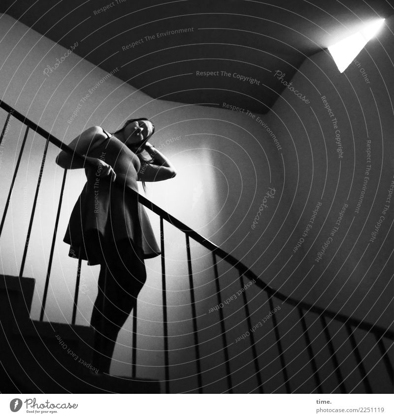 liqueur Feminine Woman Adults 1 Human being Wall (barrier) Wall (building) Stairs Staircase (Hallway) Lightshaft Banister Dress Brunette Long-haired Observe