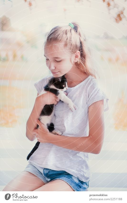Beautiful girl squatting on the porch and hugging her little cat Cat Woman Human being Youth (Young adults) Young woman Summer Sun Girl Adults Lifestyle Happy