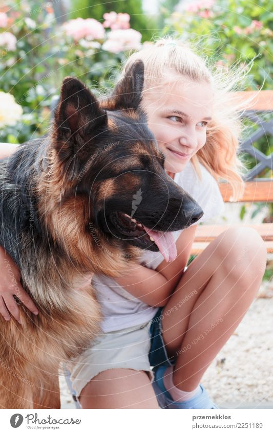 Young smiling girl squatting in the garden and hugging her dog Woman Human being Dog Youth (Young adults) Summer Animal Girl Adults Happy Together Friendship