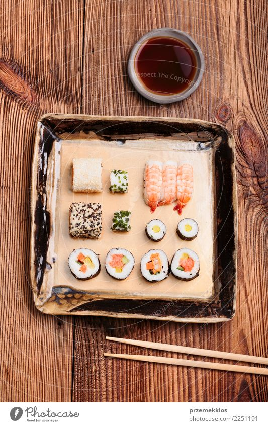 Sushi set on pottery plate with chopsticks and soy sauce Wood Food Above Fresh Table Delicious Tradition Rust Plate Cooking Meal Sense of taste Lunch Rustic