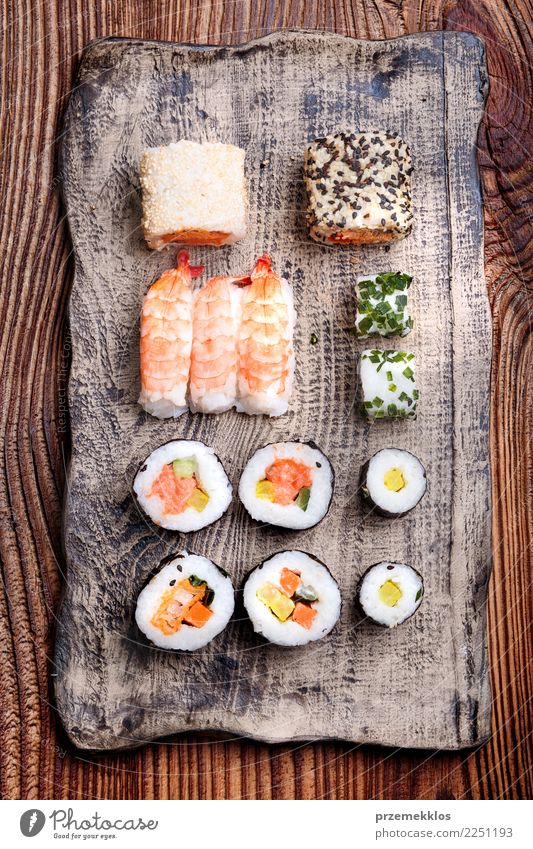 Sushi set on pottery plate Wood Food Above Fresh Table Delicious Tradition Rust Plate Cooking Meal Sense of taste Lunch Rustic Rice Set