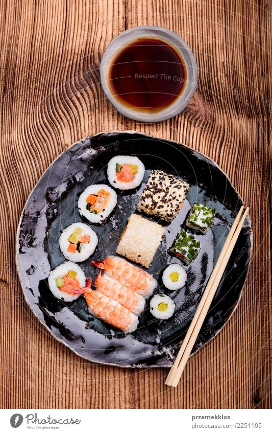 Sushi set on pottery plate with chopsticks and soy sauce Wood Food Above Fresh Table Delicious Tradition Rust Plate Cooking Meal Sense of taste Rustic Rice Set