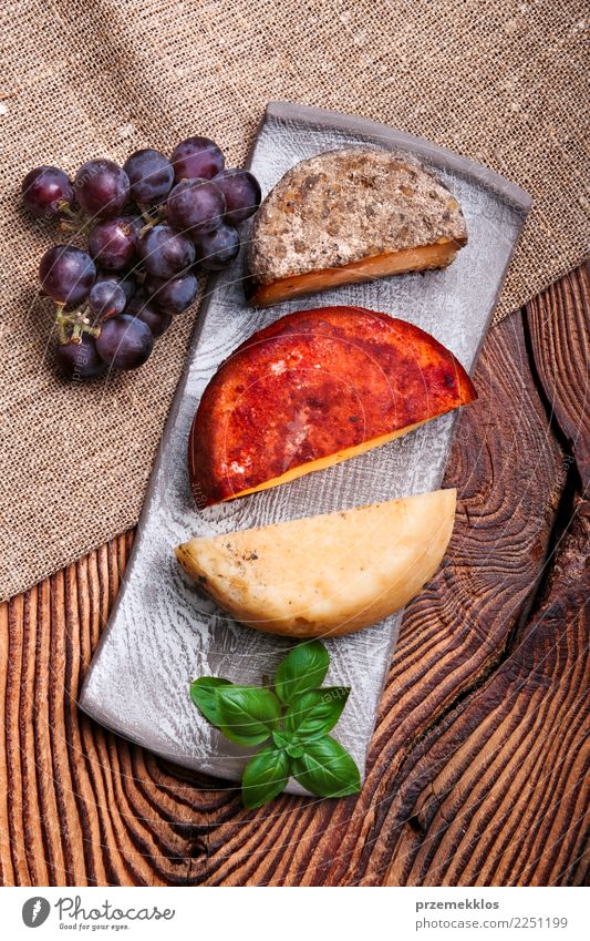 Cheese and black grapes on handmade pottery plate Wood Food Above Fruit Fresh Table Delicious Rust Plate Cooking Sense of taste Rustic Snack Bunch of grapes