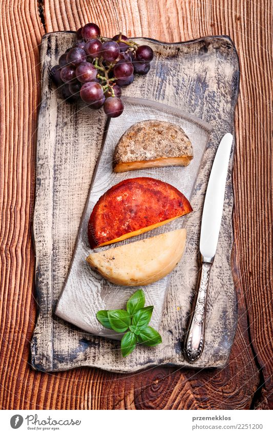 Cheese and black grapes on handmade pottery plate Wood Food Above Fruit Fresh Table Delicious Breakfast Rust Plate Cooking Sense of taste Lunch Rustic Snack
