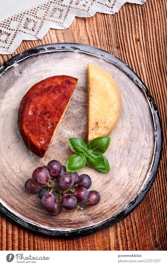 Cheese and black grapes on handmade pottery plate Wood Food Above Fruit Nutrition Fresh Table Delicious Breakfast Rust Plate Cooking Sense of taste Rustic Snack