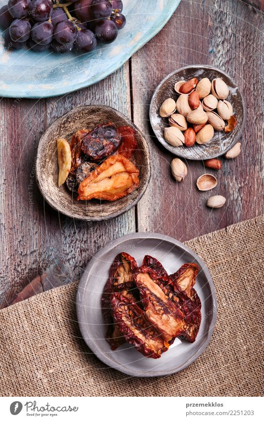 Dried fruits and nuts in handmade pottery bowls Food Fruit Dessert Bowl Table Wood Rust Delicious Above ceramic Bunch of grapes healthy overhead Rustic Snack